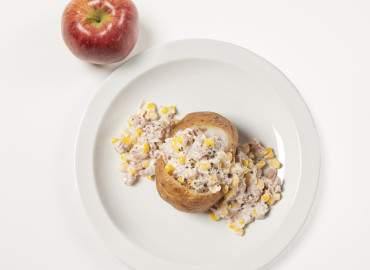 Baked Potato with tuna and sweetcorn mayonnaise filling and an apple