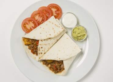 Mexican tortilla wraps with sour cream and guacamole