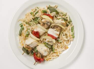 Grilled chicken and vegetable skewers with sweet chilli stir fry noodles