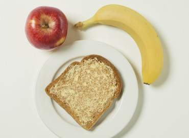 Banana, apple, and slice of toast with lower fat spread