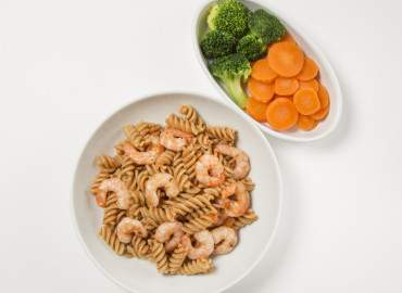 Prawn and tomato pasta and a helping of mixed vegetables