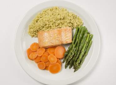 Salmon with cous cous and vegetables