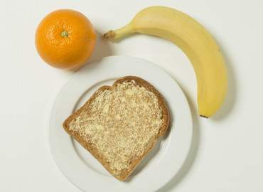 Orange, banana, slice of toast with lower fat spread