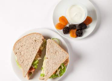Cheese and salad sandwich on wholemeal bread followed by yogurt and dried fruit