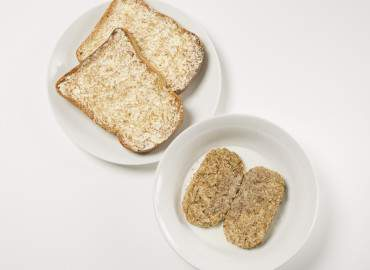 Bowl of wheat bisks and two slices of wholemeal toast with lower fat spread
