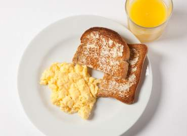 Scrambled egg, slice of wholemeal toast and lower fat spread, and a glass of fresh orange juice