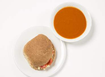 Homemade tomato soup and a cheese and tomato wholemeal roll