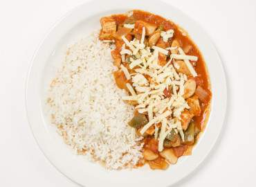 Spicy chicken and butter-bean stew with brown rice and grated cheese