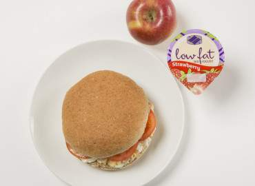 Egg and tomato mayonnaise on a wholemeal roll, followed by a low fat fruit yogurt and an apple