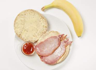 Bacon roll with tomato ketchup followed by a banana