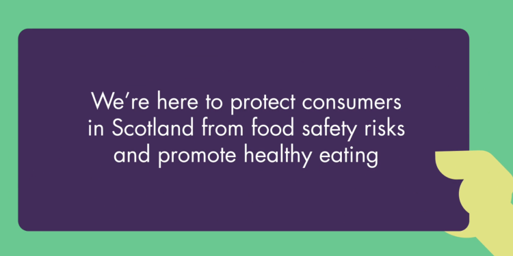 Hand holding a sign that says 'we're here to protect consumers in Scotland from food safety risks and promote healthy eating'