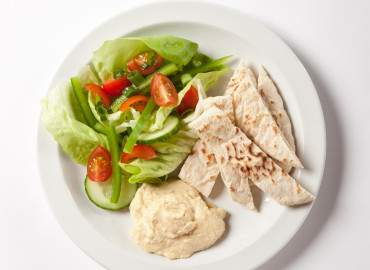 Pitta bread with houmous and a side salad