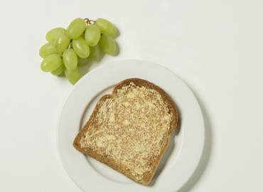 Grapes, slice of toast with lower fat spread
