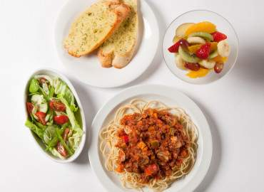 Spaghetti Bolognese with garlic bread, a side salad, followed by fruit salad