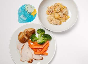 Roast chicken with potatoes and vegetables, homemade apple crumble and a pot of plain yogurt